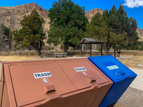 National Park picnic area with trash and recycling bins.