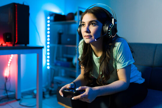 Woman using headphones and a microphone for a videogame