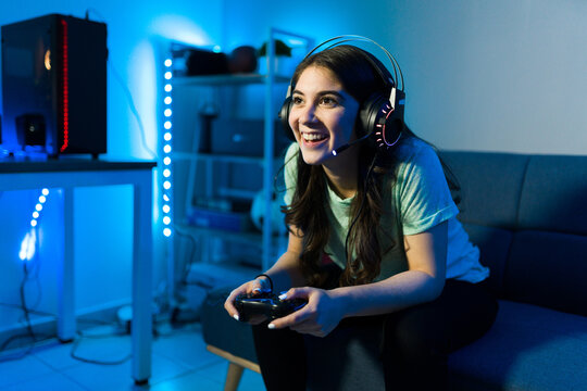 Woman gamer smiling while talking to an online player