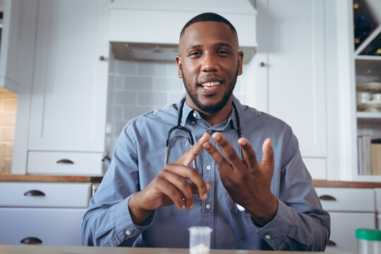 African american male doctor having a video chat
