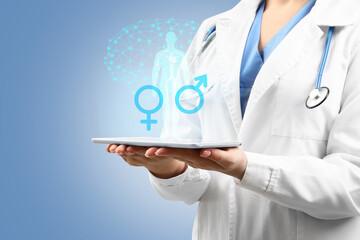 Obraz Female gynecologist with tablet computer on color background. Concept of sexual health - fototapety do salonu