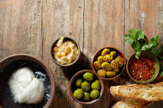 Assorted Mediterranean food on wooden table
