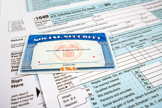 Blank social security card, and 1040 us individual tax income return form.