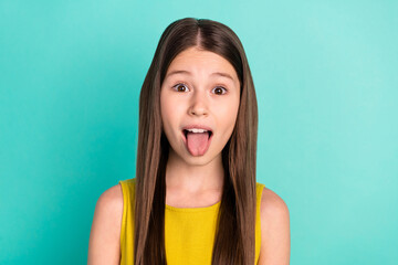 Photo of impressed nice brown hair girl wear yellow dress isolated on bright teal color background Wall mural