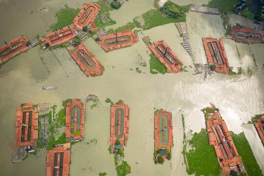 Aerial view of chimneys from local brick factories flooded by monsoon rains near Savar, Dhaka, Bangladesh.