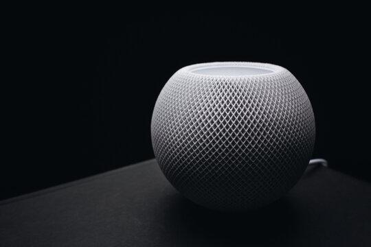 Apple HomePod mini on a dark background