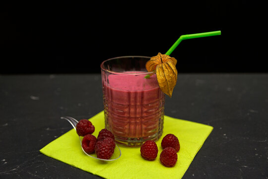 raspberry cocktail with vodka in glass