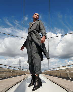 low angle view of male fashion model posing in city