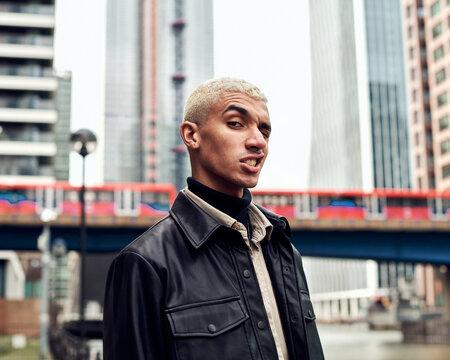 male fashion model posing in city