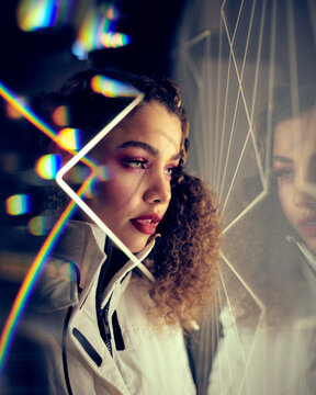 portrait of a woman with neon light reflections