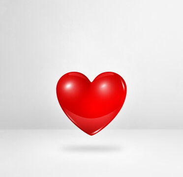 3D red heart on a white studio background