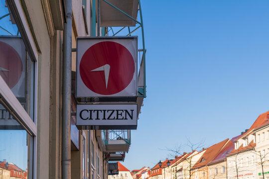 Deutschland , Calau , 03.03.2021 , Werbeschild der japanischen Marke CITIZEN an der Fassade