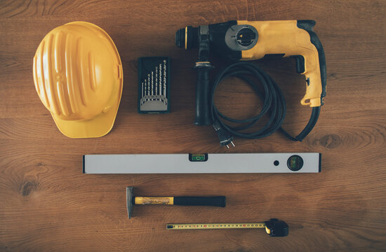 Set of construction worker tools and helmet