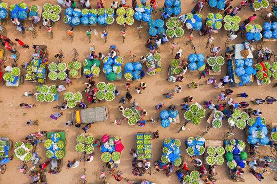 Aerial view of a few people working at Kansat mango Bazar, the largest mango market in the world, Shibganj province, Bangladesh.