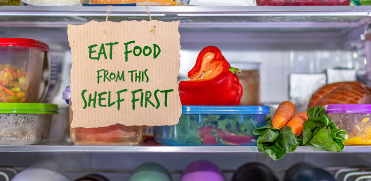 Eat Food from this shelf first handmade sign in fridge, eat food first area to help reduce food waste, know where to look first, simple reduce food waste concept.