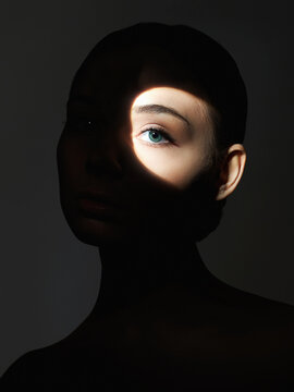 young woman with shadow on the face