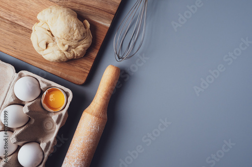 Flat Lay composition, ingredients for baking cookies on a gray background, copy space. Making cookies or cupcakes for Valentine's Day, Mother's Day, Father's Day. The concept of festive food