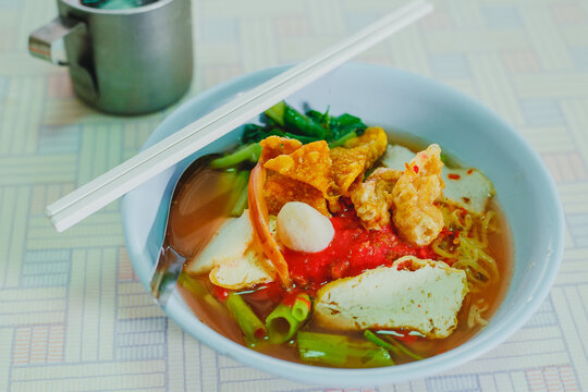 Pink seafood flat noodles with wide rice noodles. or We called Yen-ta-fo in Thailand