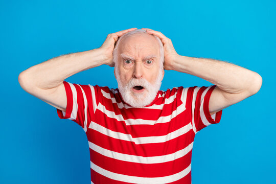 Photo of angry old grey hairdo man hand head wear red t-shirt isolated on bright blue color background