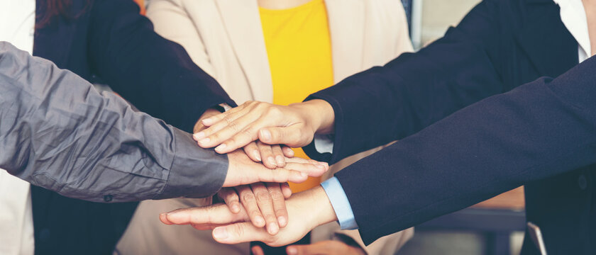 Teamwork Success. Close up hands executive business people group team happy showing teamwork and joining hands after meeting partner business in office