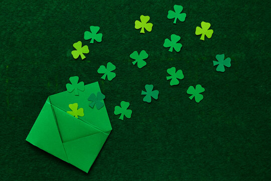 Clover leaves cut from colored paper.