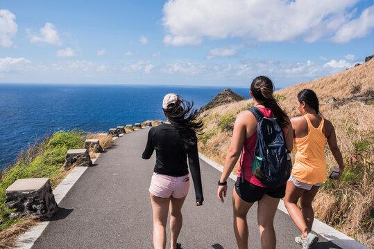 Friends walking, Lanikai Beach, Oahu, Hawaii