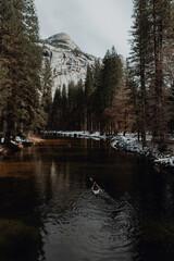 Man kayaking in lake, Yosemite Village, California, United States