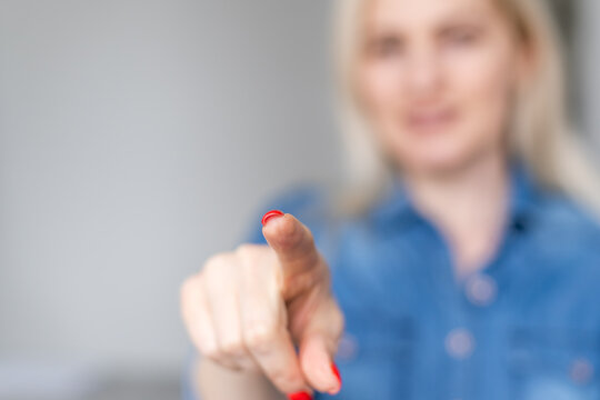 Woman touching imaginary screen with her finger