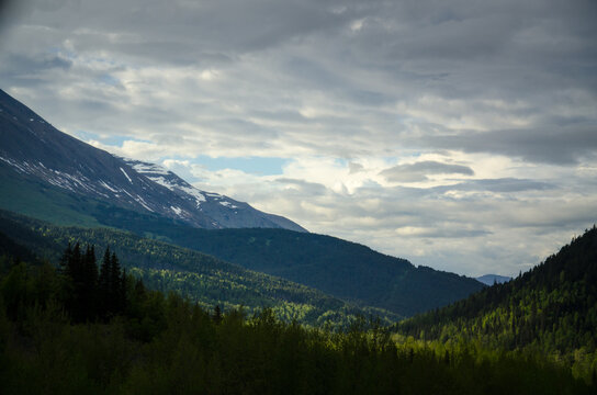 Alaskan mountains with clouds and blue sky