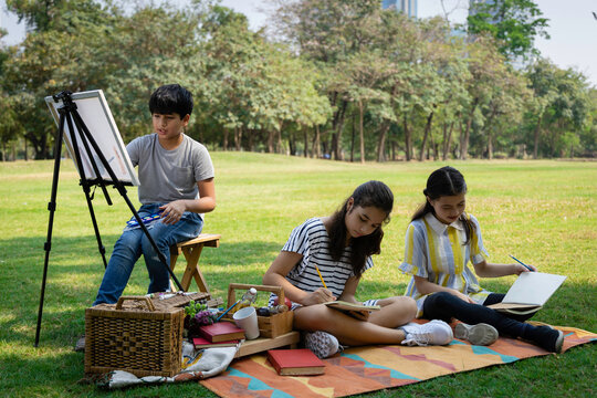 Group of children enjoyed a painting in the park Friendship and friend