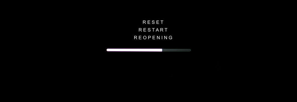 RESET, RESTART and REOPENING concept, Loading sign on black computer screen
