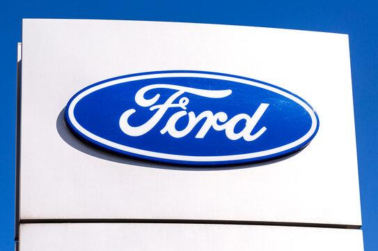 Ford dealership sign against a blue sky