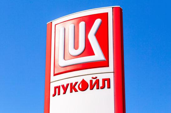 Lukoil dealership sign against a blue sky