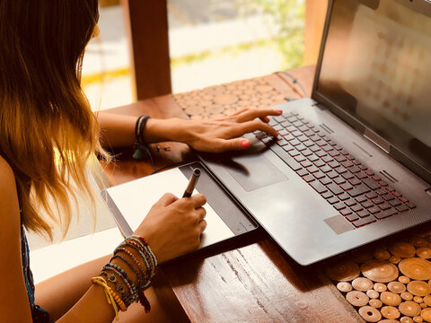 Woman working from home, using laptop notebook, modern freelance concept.