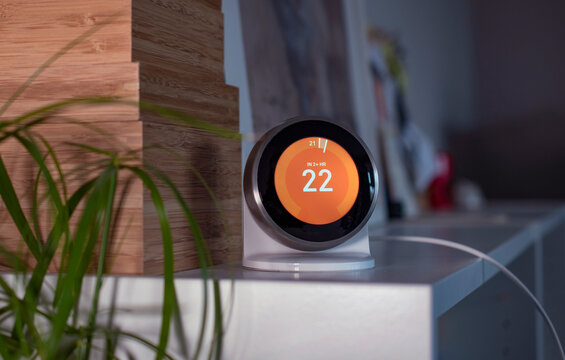 A modern wifi thermostat in a cozy home in soft evening light