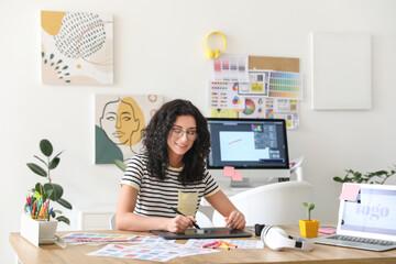 Obraz Young female designer working in office - fototapety do salonu