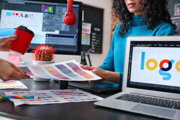Obraz Female designer with colleague working in office - fototapety do salonu