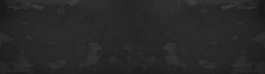 Black anthracite grunge stone concrete plaster facade wall texture background panorama banner long