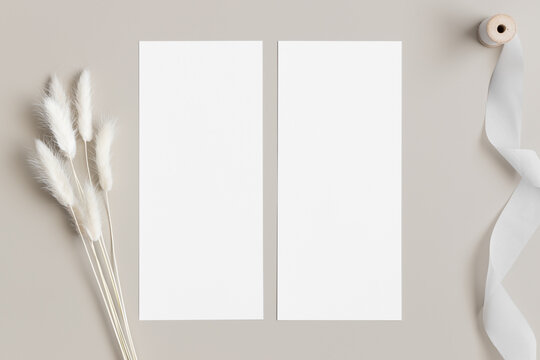 Two menu cards mockup with a satin tape and a lagurus deocoration, 4x9 ratio.