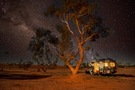 Camping at night in the Strzelecki desert , South Australia.