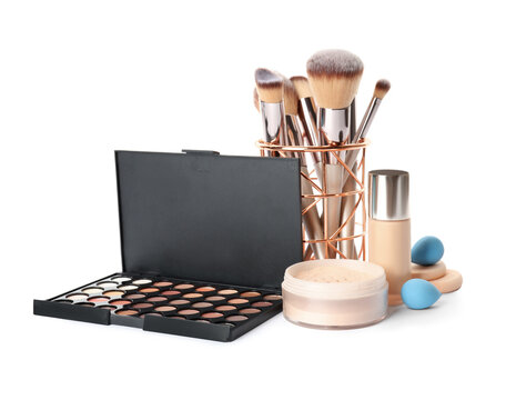 Set of makeup products and accessories on white background