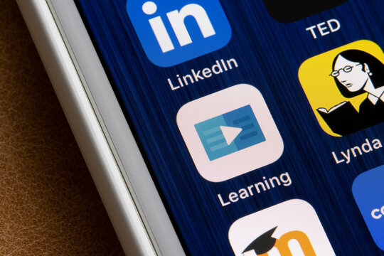 Portland, OR, USA - Mar 6, 2021: LinkedIn Learning app icon is seen next to Lynda.com app on an iPhone. Lynda.com has been completely migrated over to LinkedIn Learning as of 2019.