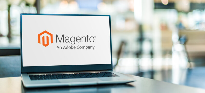 Laptop computer displaying logo of Magento