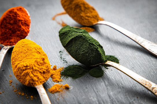 spirulina  ginger  turmeric powder in spoons superfoods