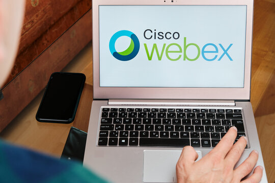 Webex Meetings is used for business meeting on laptop by man. An illustrative editorial image. San Francisco, US, June 2020.