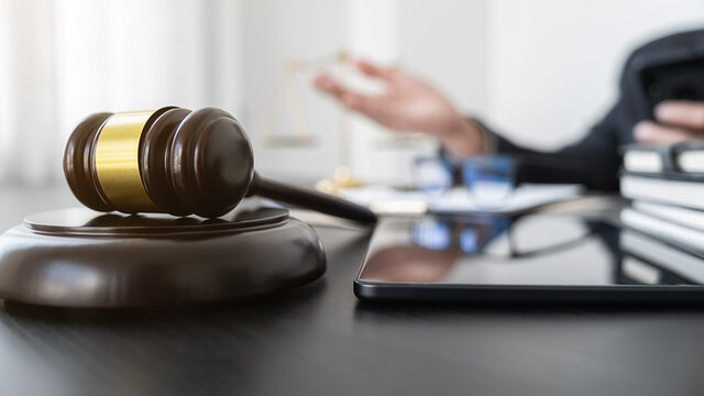Professional lawyer considering with contract papers in courtroom. Justice, Law, Attorney and Court judge concept.