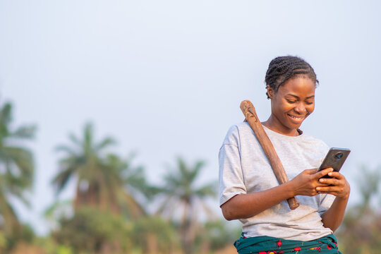 female african farmer using her phone