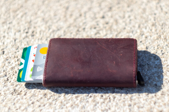 Forgotten wallet with credit cards on the ground close up