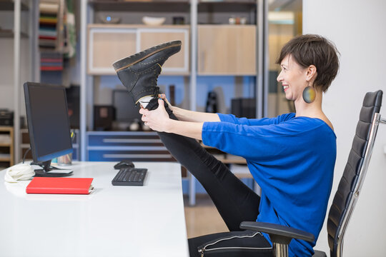 woman practicing yoga in the office