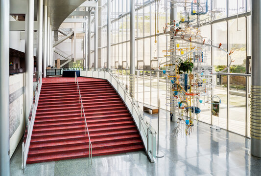 Light and airy atrium of a modern building with marble floors.